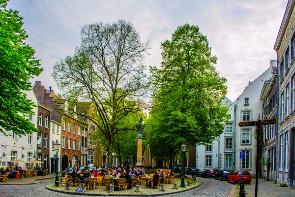 MAASTRICHT, NETHERLANDS, APRIL 12, 2014: Historical center of dutch city maastricht is full of narrow streets with bars, restaurants and resting areas.